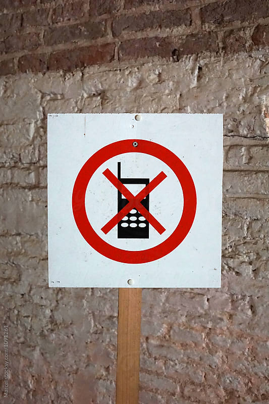 Mobile phone forbidden sign by Marcel for Stocksy United