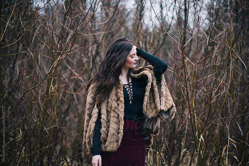 Girl wearing fur cape by Michelle Moore for Stocksy United