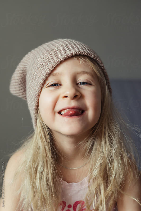 portrait of child  with hat by Javier Pardina for Stocksy United