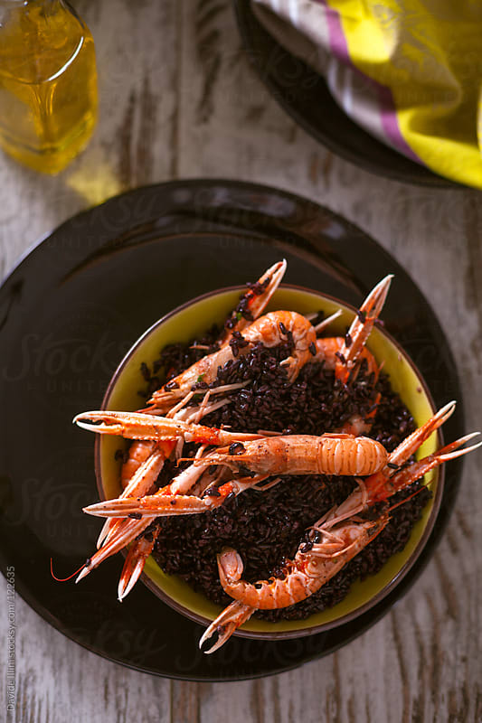 Venere rice with prawns by Davide Illini for Stocksy United
