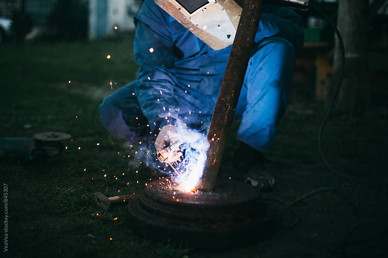 Welder welding outdoors by VeaVea for Stocksy United