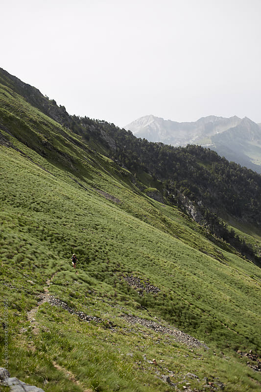 Mountain trail and backpacker in the Pyrenees by Miquel Llonch for Stocksy United