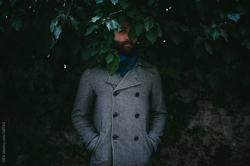 Elegant Beard Man Hide By Leaves by HEX. for Stocksy United