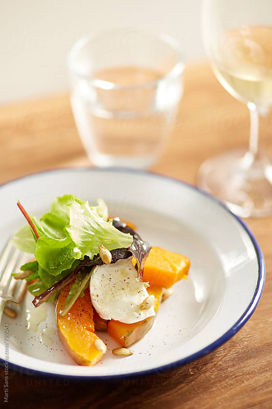 Roasted pumpkin salad by Martí Sans for Stocksy United