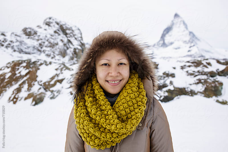 An asian tourist in Zermatt by Felix Hug for Stocksy United