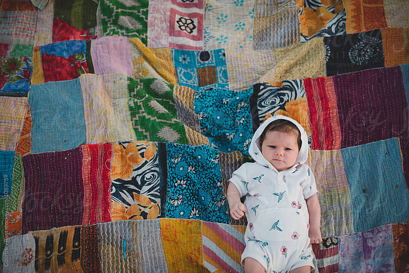 Baby on a beach blanket by Courtney Rust for Stocksy United