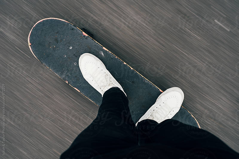 Feet on moving skateboard by Isaiah & Taylor Photography for Stocksy United