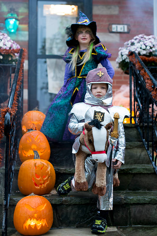 Boy and Girl Trick or Treating on Halloween with Costumes by JP Danko for Stocksy United