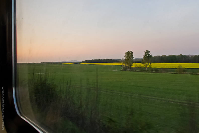 Spring landscape as seen from a moving train by Melanie Kintz for Stocksy United