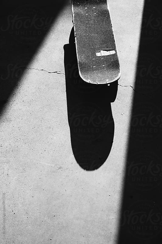 Skateboard on concrete by Curtis Kim for Stocksy United