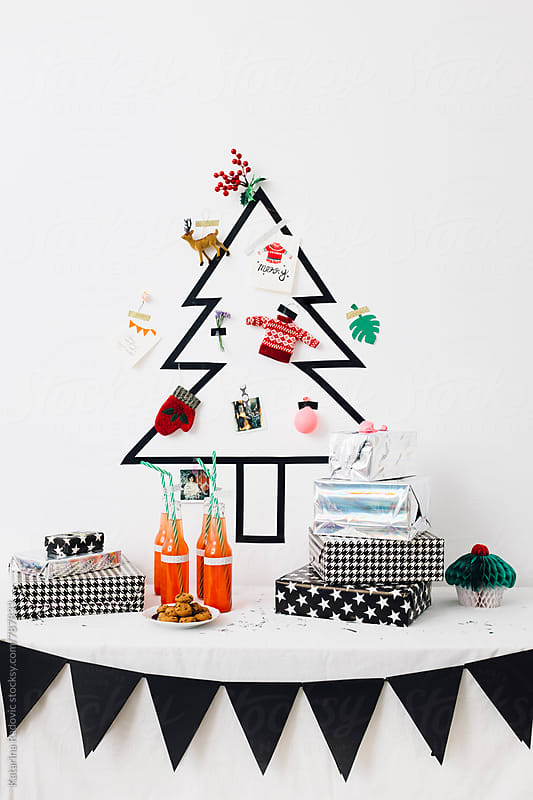 DIY Christmas Tree With Presents And Drink Ready for Party by Katarina Radovic for Stocksy United