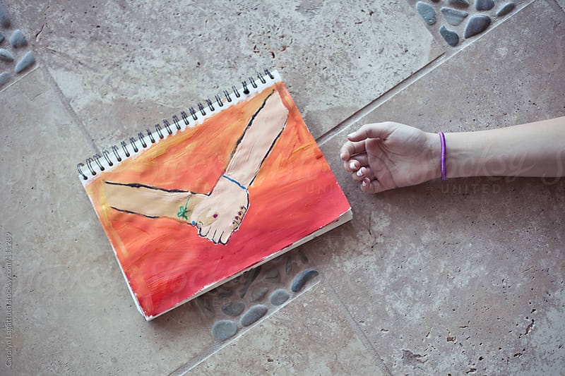 Hand painted photo of friends holding hands and a girl's open hand next to it by Carolyn Lagattuta for Stocksy United