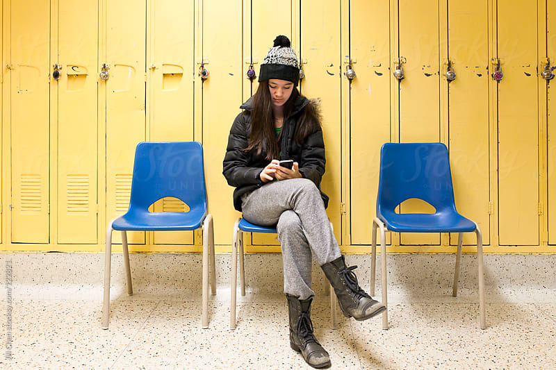 Student Texting in School by Jill Chen for Stocksy United