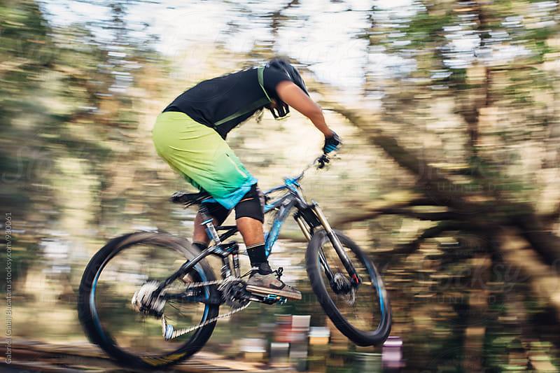 Male mountain bike rider motion blur by Gabriel (Gabi) Bucataru for Stocksy United