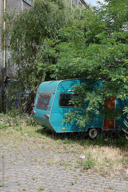 cool urban caravan under a tree by Marcel for Stocksy United