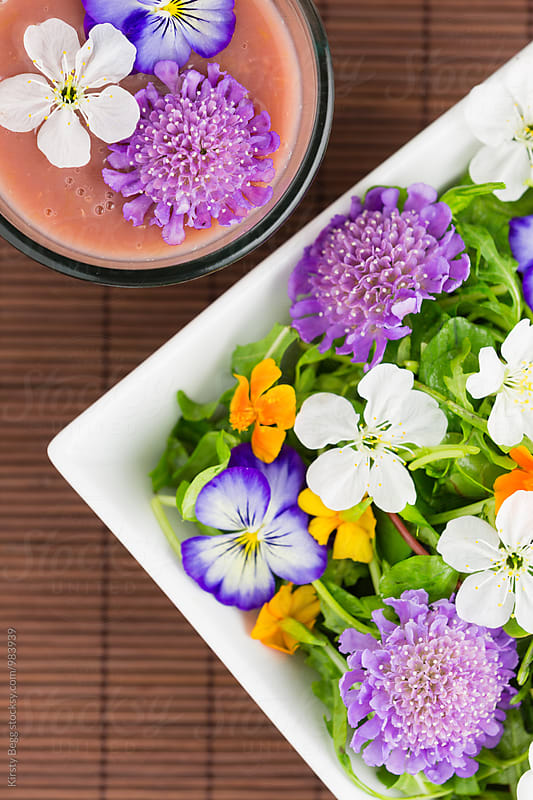 Edible flower salad with a fruit smoothie by Kirsty Begg for Stocksy United