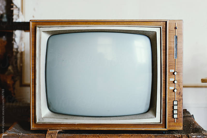 Vintage television tube with blank screen by Amir Kaljikovic for Stocksy United