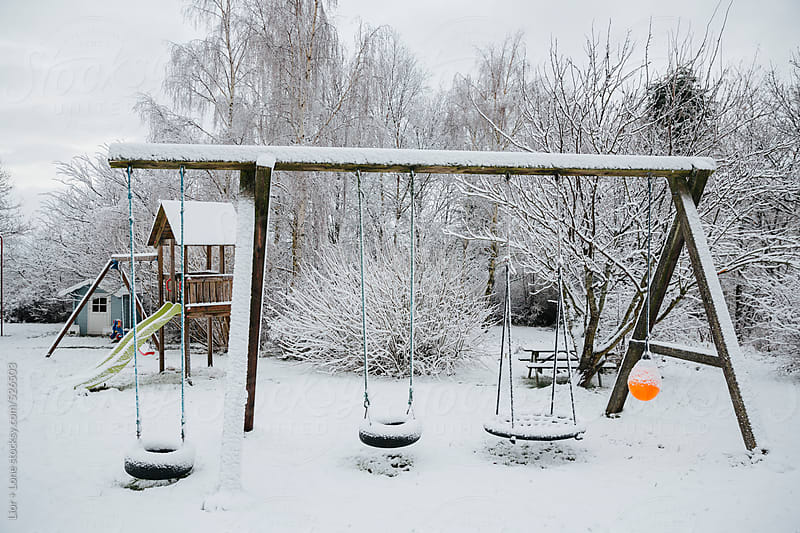 Playground in winter covered in snow by Lior + Lone for Stocksy United