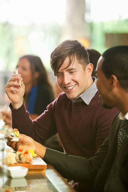 Sushi: Man with Friend at Sushi Bar by Sean Locke for Stocksy United