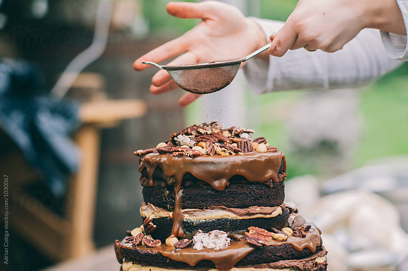 Decorating the cake with cocoa by Adrian Cotiga for Stocksy United