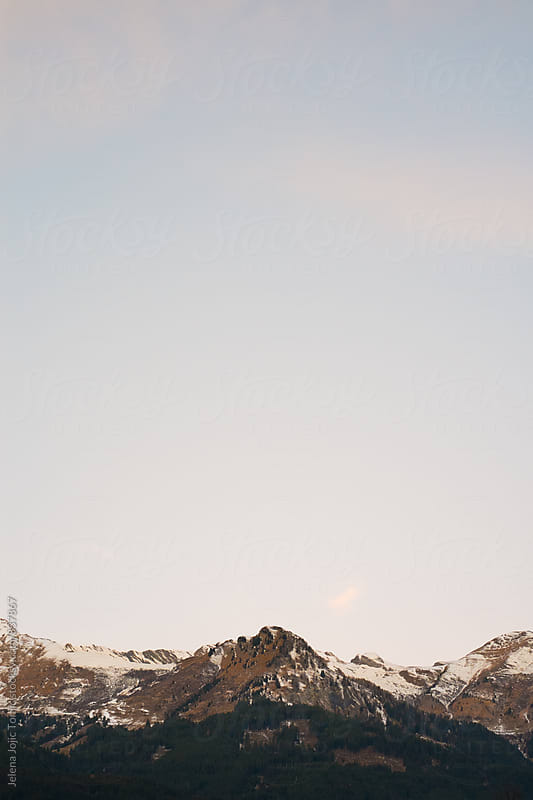 Sunrise at the snowy mountain tops by Jelena Jojic Tomic for Stocksy United