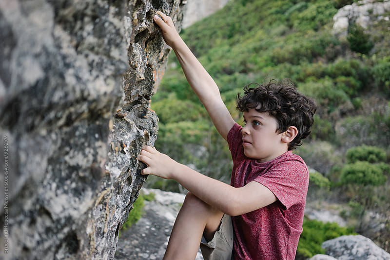 Boy Rock Climbing by Bruce and Rebecca Meissner for Stocksy United