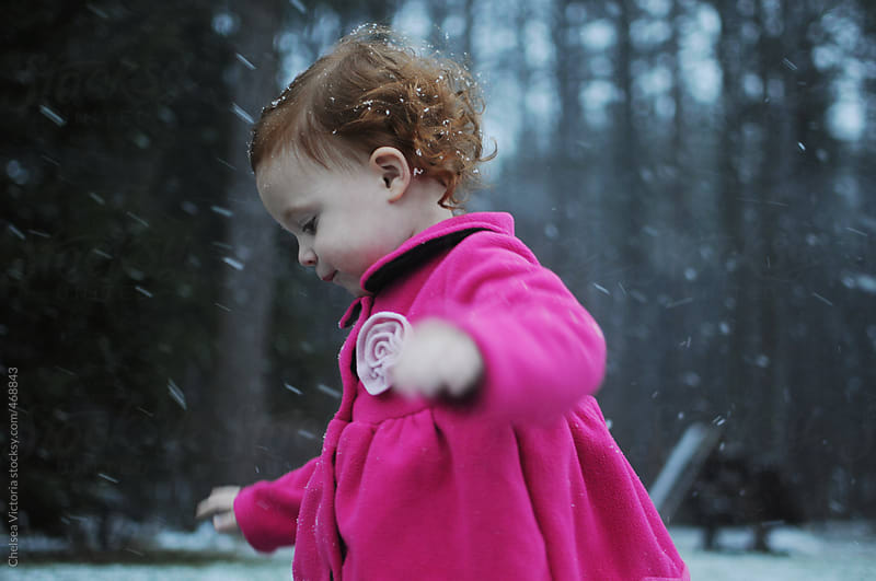 Toddler standing in the snow by Chelsea Victoria for Stocksy United