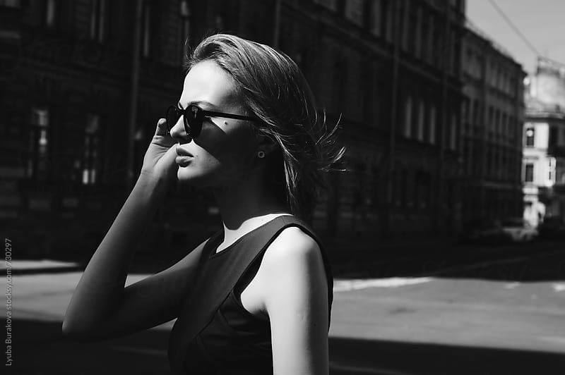 Woman wearing sunglasses  by Lyuba Burakova for Stocksy United