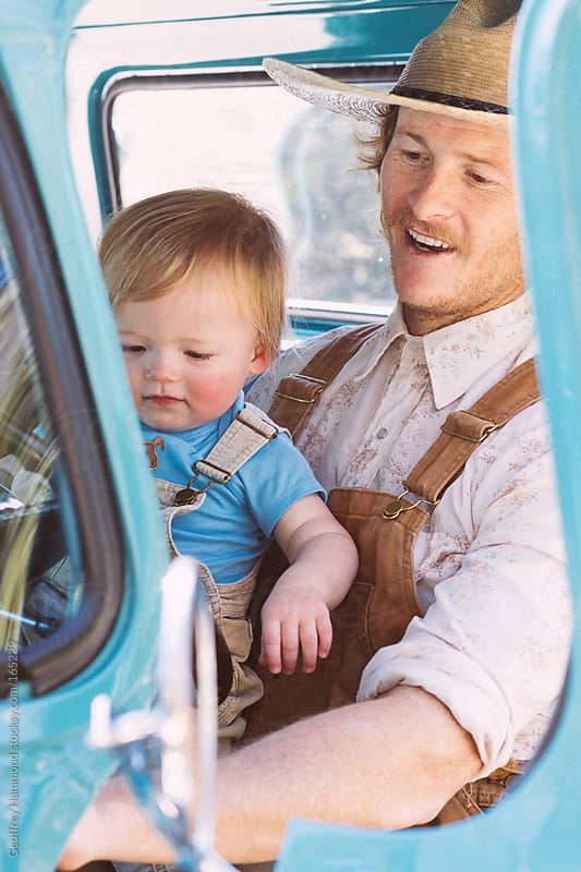 Young Father Plays with His Son in Pickup Truck by Geoffrey Hammond for Stocksy United