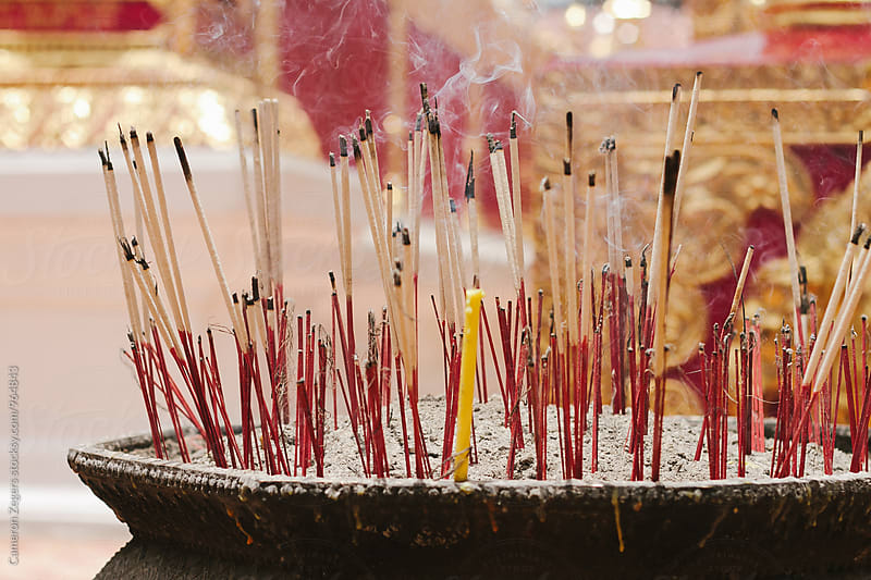 incense burning at Thai temple by Cameron Zegers for Stocksy United