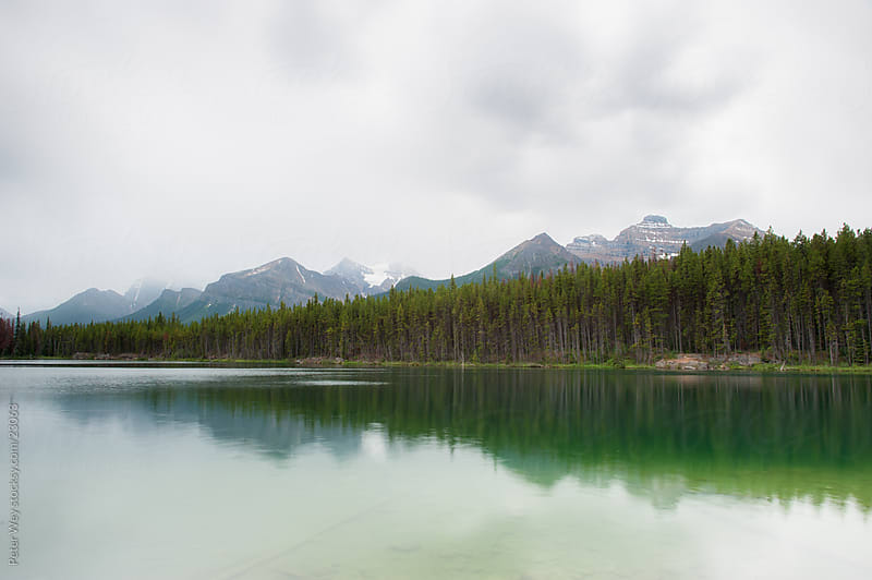 Cloudy mountain panorama from Herbert Lake by Peter Wey for Stocksy United