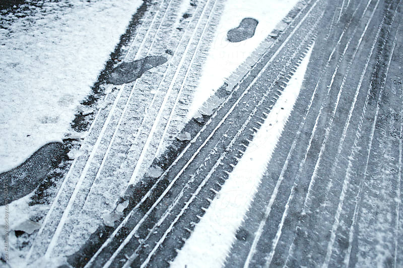 Commuting in winter – tyre tracks in snow by Jon Attaway for Stocksy United