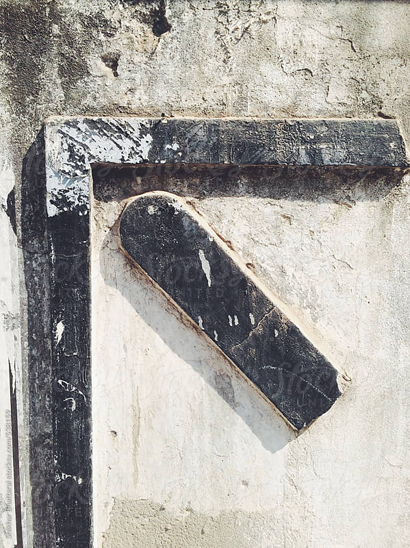 Upward arround sign on a wall. by Shikhar Bhattarai for Stocksy United