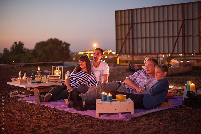 Friends Enjoying Open Air Cinema by Mosuno for Stocksy United