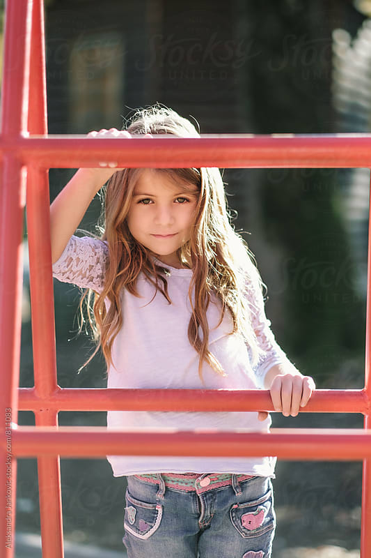 Little Girl at the Playground by Aleksandra Jankovic for Stocksy United