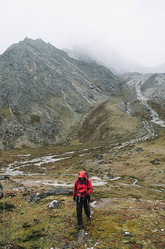 Female trekker descending from Kongma La Pass, Everest Region, Sagarmatha National Park, Nepal. by Thomas Pickard for Stocksy United
