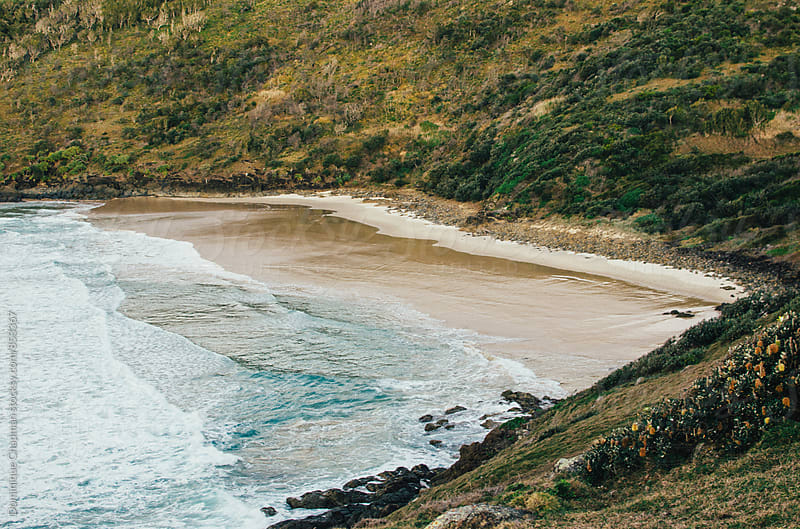 Landscape image of hidden beach by Dominique Chapman for Stocksy United