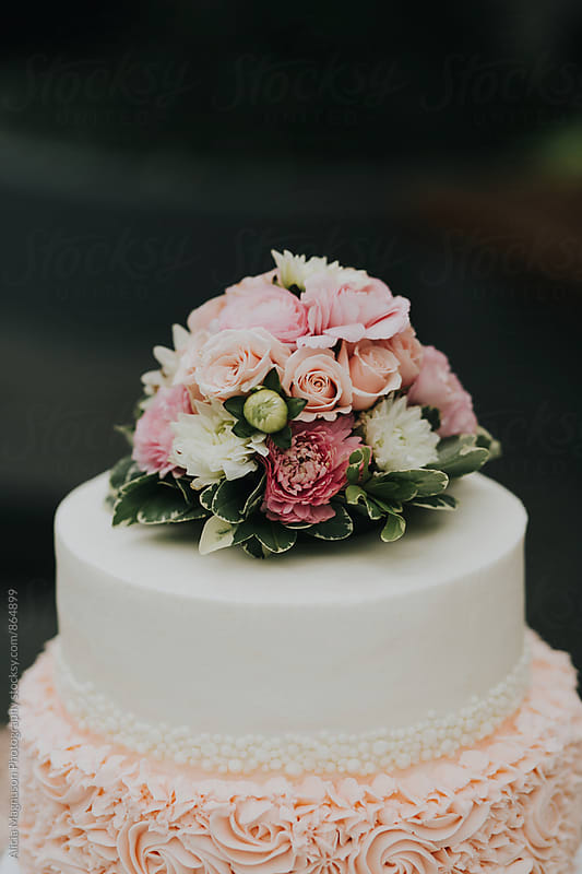 Detail of Blush Pink and White Wedding Cake by Alicia Magnuson Photography for Stocksy United