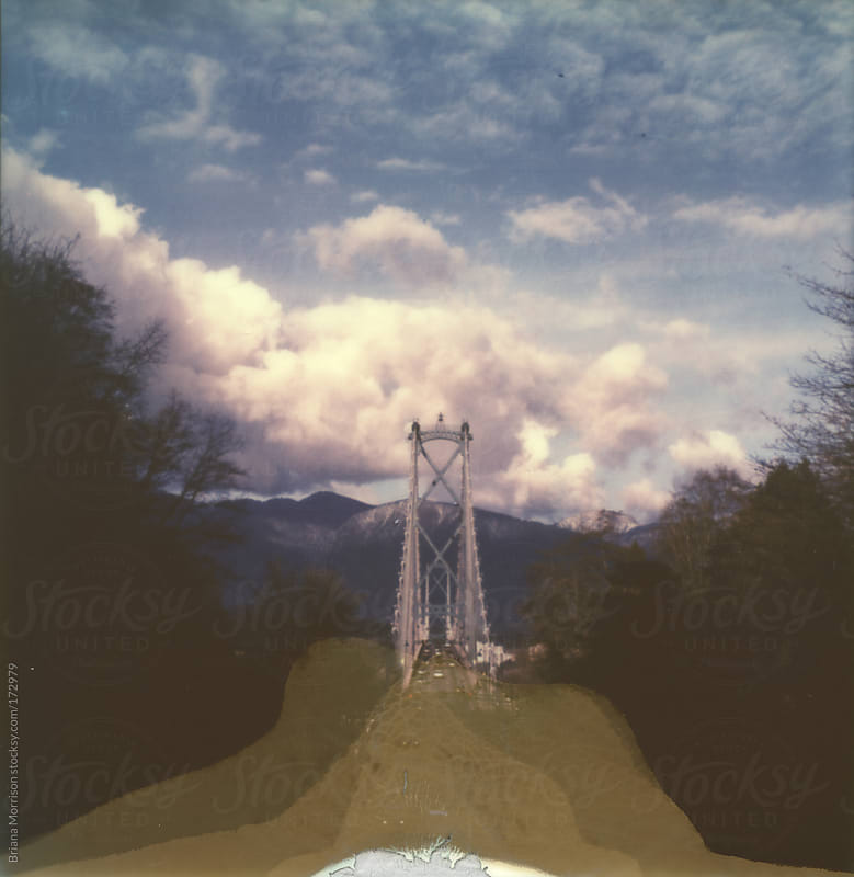 Polaroid of Bridge and Clouds with Cracked Emulsion by Briana Morrison for Stocksy United