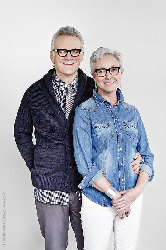 Portrait of stylish mature couple with grey hair  by Trinette Reed for Stocksy United